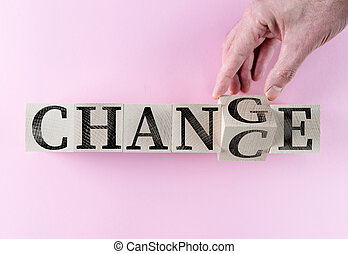 hand turning word CHANGE into CHANCE on wooden blocks