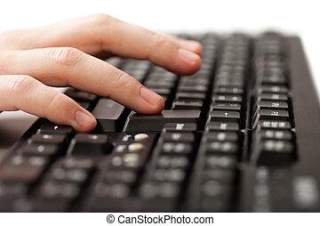 Hand typing computer keyboard