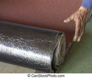hand unroll roof roll - Human hand unroll bitumen roll of...