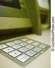 Hand Using ATM Keyboard
