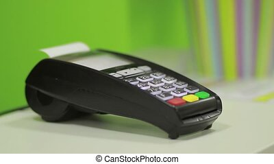 Hand using bank terminal for credit card payment - Female...