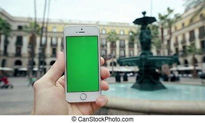 Hand Using Green Screen Smart Phone , Waterworks