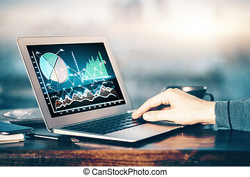 Fund management concept - Hand using laptop with forex chart...