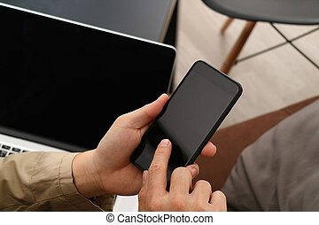 hand using smart phone and digital tablet computer for online banking payment communication in modern office