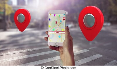 Animation of hand holding smartphone with map on screen and red location pins. Global online network digital interface concept digitally generated image.