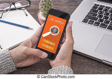 hand using smartphone with Job Search web homepage on screen. concept interview, hiring, recruitment.
