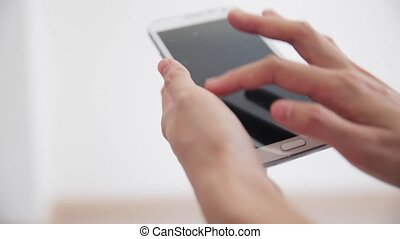 hand using writing on smart phone