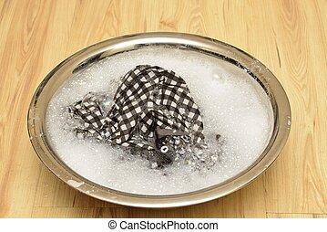 hand wash basin in a plaid shirt