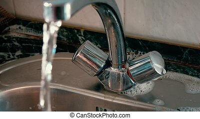 Hand washing kitchen sink - Woman washing kitchen sink....