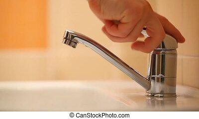 Hand washing - Man washing his hands in the bathroom