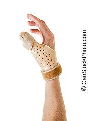 Hand Wearing Brace Over Thumb in White Studio