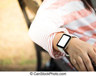 Hand wearing smartwatch