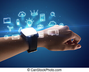 Hand wearing smartwatch with multimedia symbols