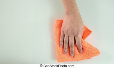 Hand wipe the cleaning towel. white table