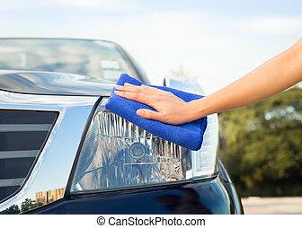hand wiping car
