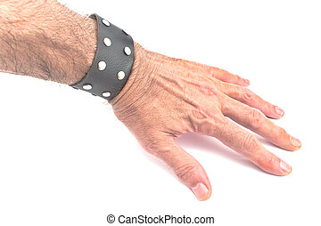Hand with a black leather bracelet on white