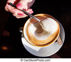 Hand with a cup of coffee