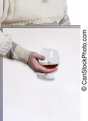 Hand with a glass of cognac