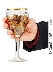 Hand with a glass of the money on a white background