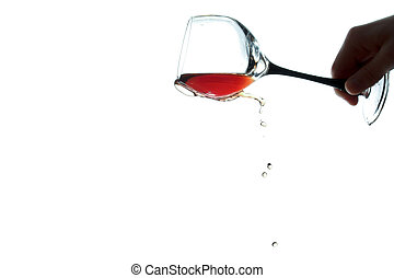 hand with a glass of wine the wine is poured from a glass isolated on white background
