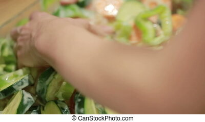 hand with a knife cut vegetables for frying