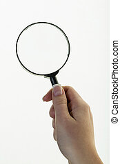 hand with a magnifying glass