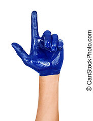 hand with a raised index finger, painted in blue paint isolated