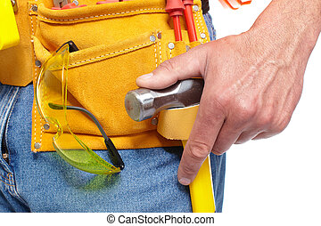 Hand with a Tool belt. Renovation. - Worker with a tool...
