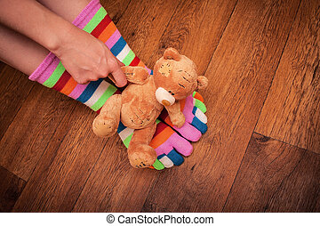 hand with a toy on their feet