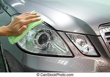 Hand with a wipe microfiber the car polishing