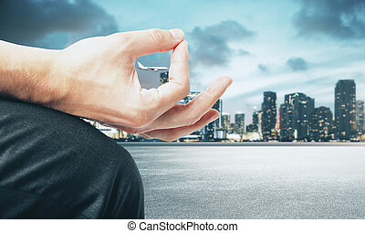 Hand with airplane on city background