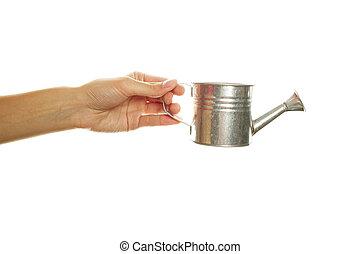 Hand with an iron watering can