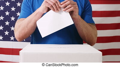 Hand with ballot and box in USA - Man casting a vote in ...