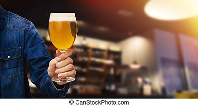 hand with beer glass in the pub