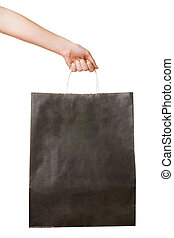 Hand with black paper bag on white