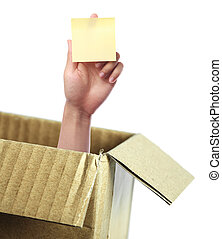 Hand with blank sticky note out of box