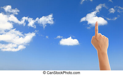 hand with blue sky and white cloud