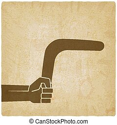 hand with boomerang old background. vector illustration -...