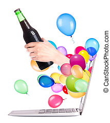 hand with bottle of beer and laptop