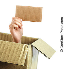 Hand with brown card out of box