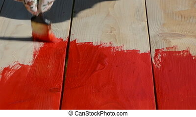 paint in red a wooden  boards