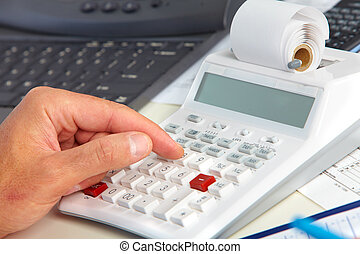 Hand with calculator. - Hand of accountant man with...