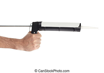 Hand with caulking gun on white