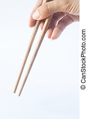 Hand with chopsticks isolated on white background, copy space