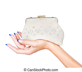 hand with clutch - isolated body part shot of beautiful...