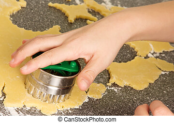 Hand with cookie cutter