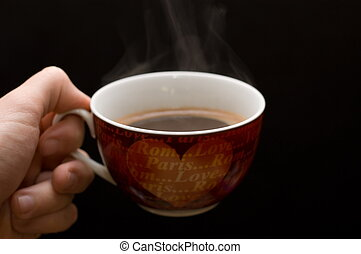 Hand with cup of coffee