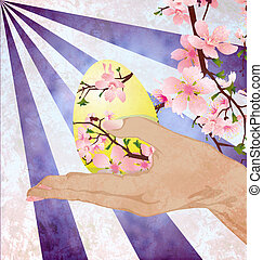hand with easter egg decorated with pink tree flowers on grunge background