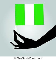 Hand with flag Nigeria