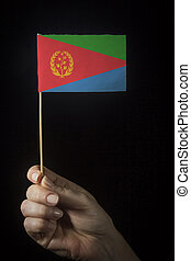 Hand with flag of Eritrea